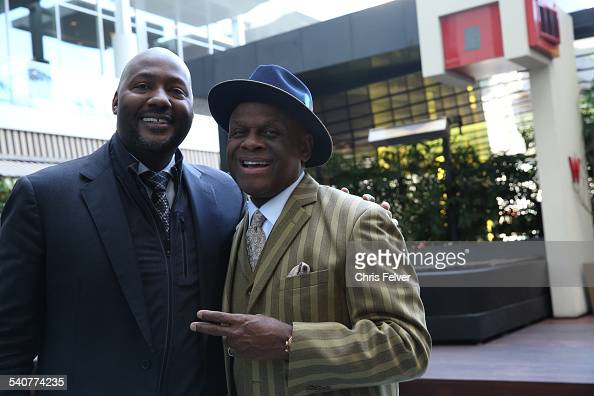 At an event in honor of comedian Dick Gregory and his Hollywood Walk of Fame star Gregory's son Christian poses actor and comedian Michael Colyar...