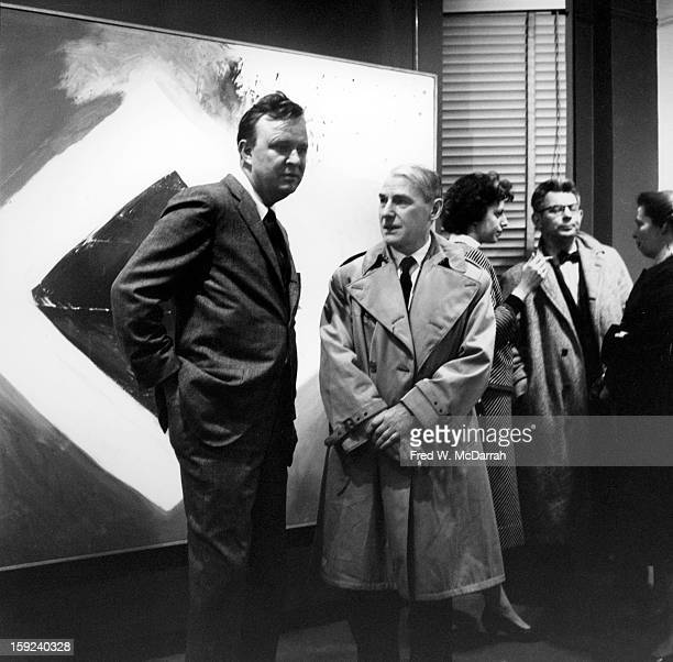 At an exhibition of his work in the at Sidney Janis Gallery American abstract expressionist Robert Motherwell poses with Dutch American artist Willem...