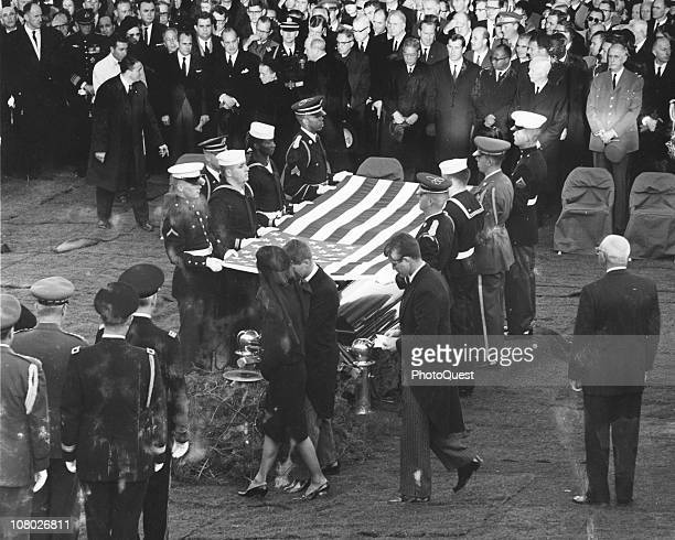 At Arlington National Cemetary Jacqueline Kennedy accompanied by her brothersinlaw Robert F Kennedy and Ted Kennedy approach the gravesite of...