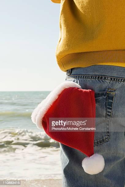 At beach looking at the view, Santa hat in back pocket