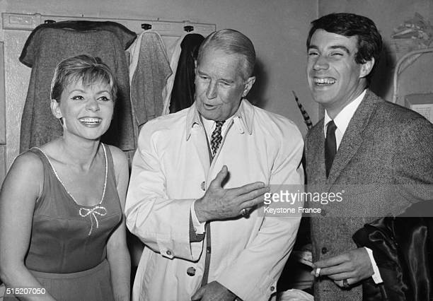 At Bobino cabaret Annie Cordy congratulated by Maurice Chevalier and Franck Fernandel on October 13 1964 in Paris France