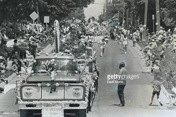 At Brampton the flowers come marching in As spectators line the street majorettes escort the flowerdecked floats in 9th annual Brampton Flower...