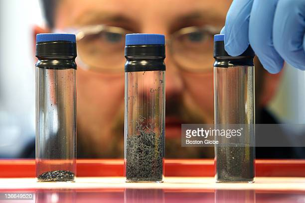 At Cabot Corporation Senior Researcher Matt Hesketh examines the progression of graphene in three vials The vial on the left is graphite the middle...