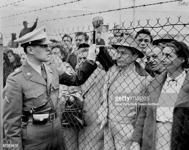 At Camp Kilmer where Hungarian refugees were temporarily housed Bill Vestesy asks a MP if he has seen his mother and brother among the refugees