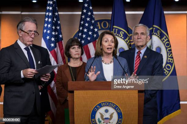 At center House Minority Leader Nancy Pelosi speaks during a news conference on Republican plans to end the state and local tax deduction on Capitol...