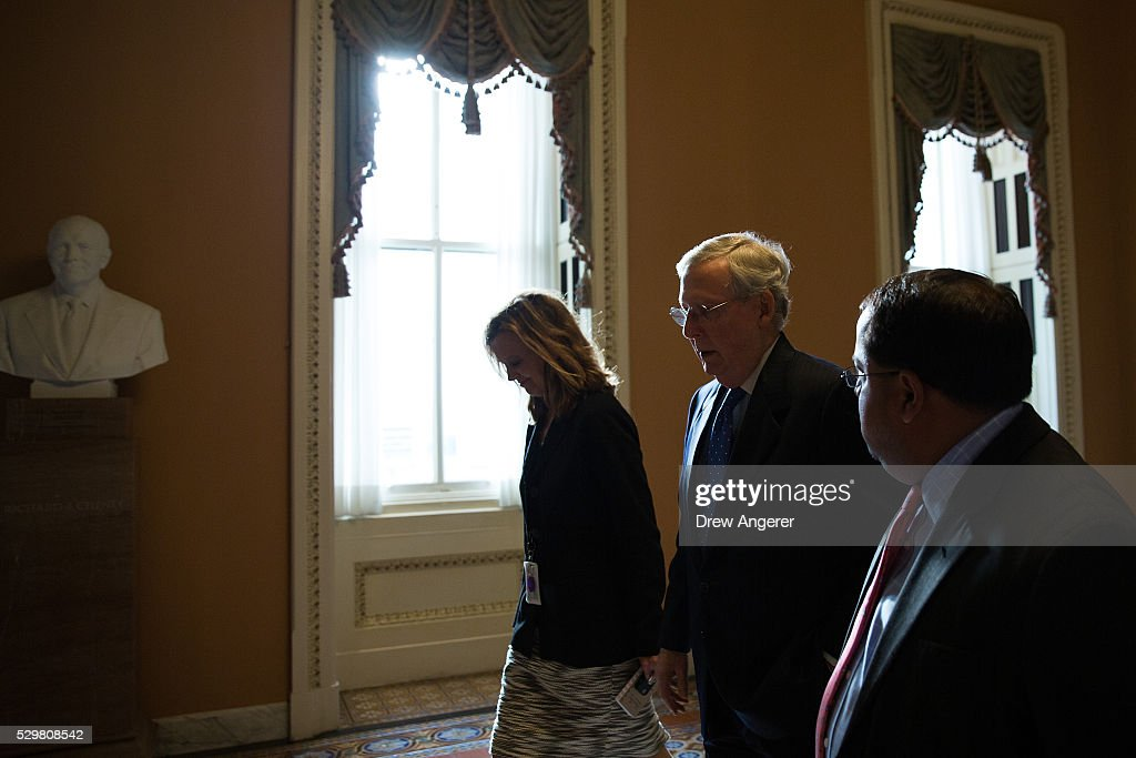 At center, Senate Majority Leader Mitch McConnell (R-KY) walks to his office after speaking on the Senate floor at the U.S. Capitol, May 9, 2016, in Washington, DC. Senate Democrats defeated a procedural vote on an energy bill, which increases funding for the Department of Energy and Army Corps of Engineers.