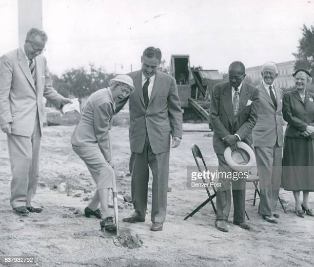 At ceremonies Friday morning Miss Helen I Ingersoll tossed up a shovelful of dirt as first move in construction of Denver's new $1000 library at...
