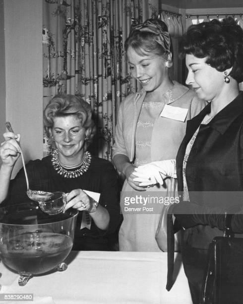 At 'Champagne And Roses' Party Mrs Phinn W Townsend Denver Petroleum AIME wives president pours for Mrs Jerrold Hurd center Mrs B W Cannon at...