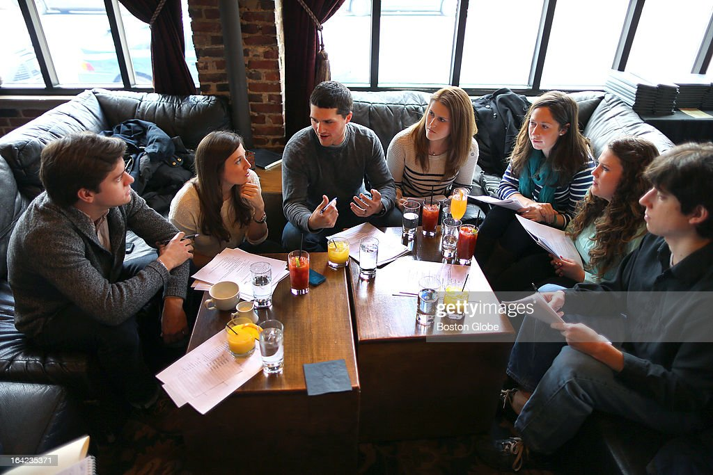 At Church restaurant, a group of young people from Newtown, Conn., left to right, Will Jacob, Jill Tanner, Pete Ogerri, Laura Ogerri, Sarah Salbu, Erin Clark and Eddie Small discuss ideas for fundraising to build a children's museum in Newtown.