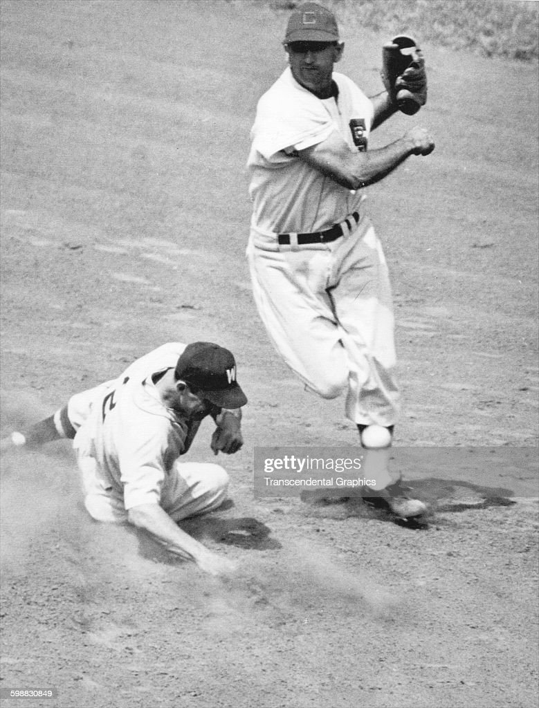 At Comiskey Park baseball player Luis Aparicio of the Chicago White Sox completes a double play as he avoids the Washington Senators' Al Kozar...