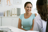 Doctor reassuring Vietnamese woman