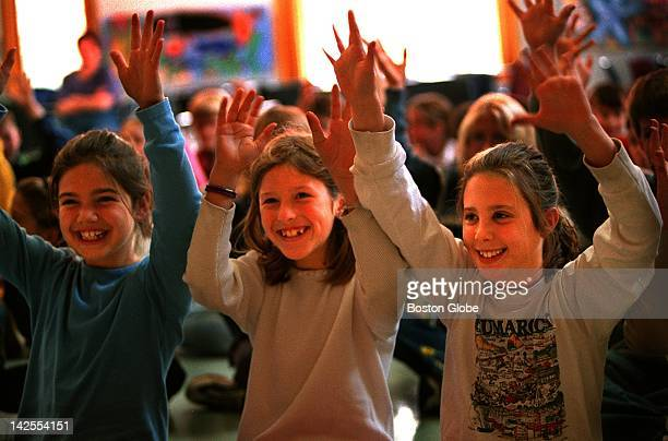 At Eames Way Elementary School students left to right Alexandra Schorle Amanda Bilas and Lizzie Russo applaud in sign language during a performance...