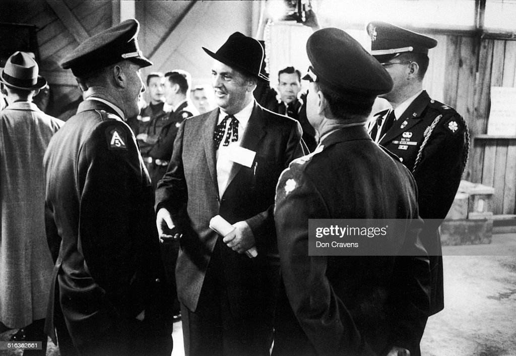 At Fort Chaffee Training Center Elvis Presley's manager Colonel Tom Parker smiles with US military officials during Presley's Army induction near...