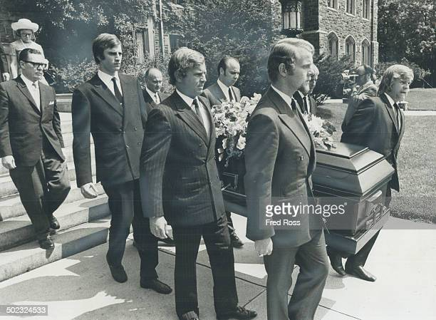 At funeral of Lady Eaton grandsons acting as pallbearers carry casket from the Timothy Eaton Memorial Church on St Clair Ave W Lady Eaton widow of...