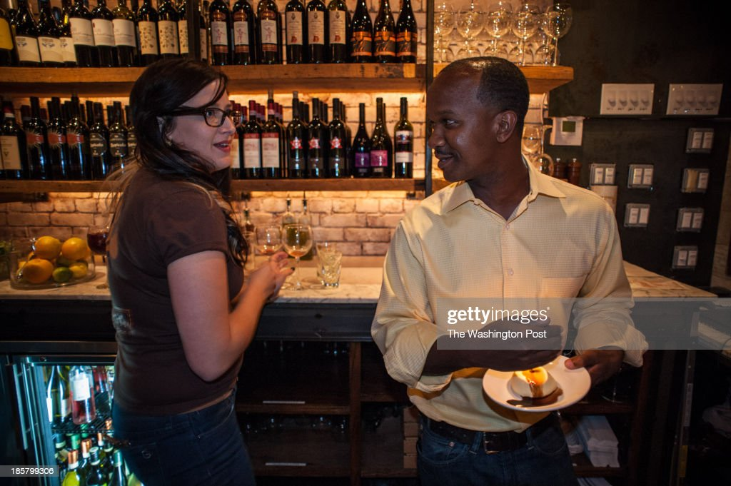 At Ghibellina, Ralph checks with bartender Chelsea DeMark before presenting a birthday dessert to a customer Ralph Lee, 31, co-owner of Acqua Al 2 on Capitol HIll and Ghibellina on 14th St., grew up in predominantly black HIllcrest in Southeast, but attended the exclusive Sidwell Friends school in Northwest. He's part of the young set of movers and shakers who are revitalizing the District.