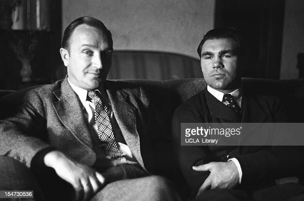 At his training camp German boxer Max Schmeling sits with an unidentified man on a sofa Napanoch New York 1936