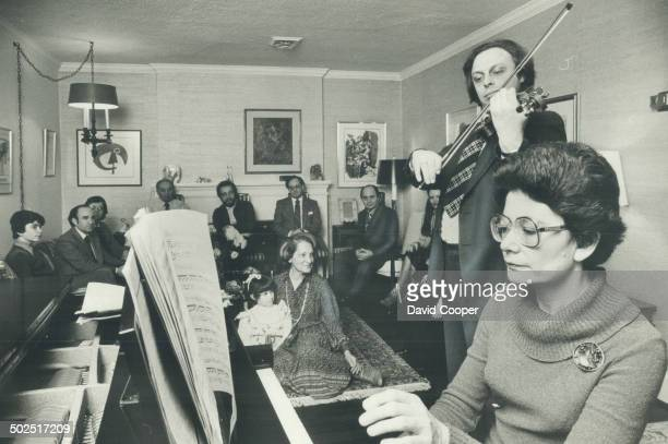 At home Musician Ruth Cooper sitting on floor with granddaughter Neri Cooper and Susan Yanivker listens to pianist Marina Geringas and violinist...