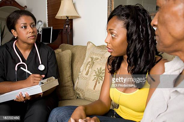 At Home Nurse Giving Bad News to Patient