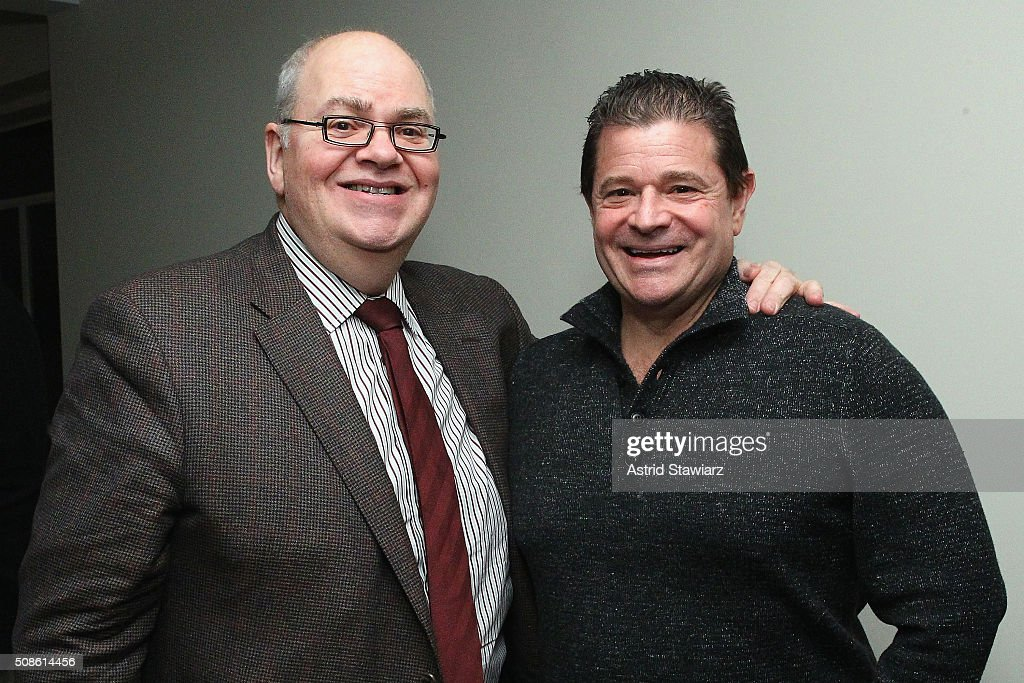 CFO at Hudson's Bay Company Paul Beesley (L) and Kevin Levinson attend an intimate evening of friends and colleagues at Mr. Colin Dougherty's New York City apartment on February 5, 2016 in New York City.