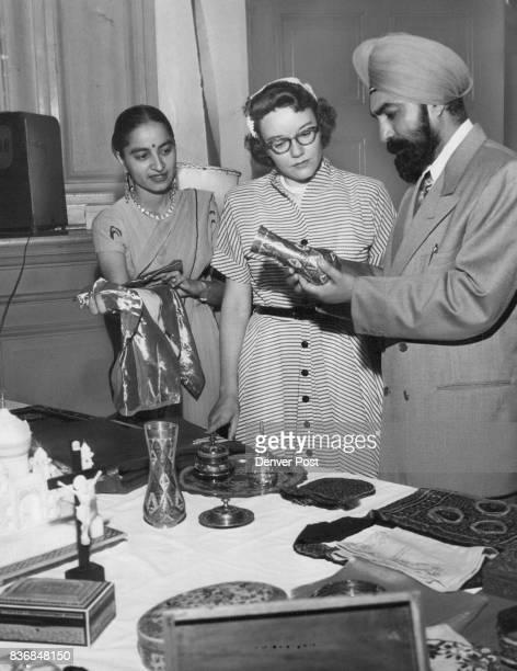 At Indian CelebrationLooking over Indian handiwork at the Indian Independence day celebration Friday night are Mrs Mukti Kapila of Punjab India...