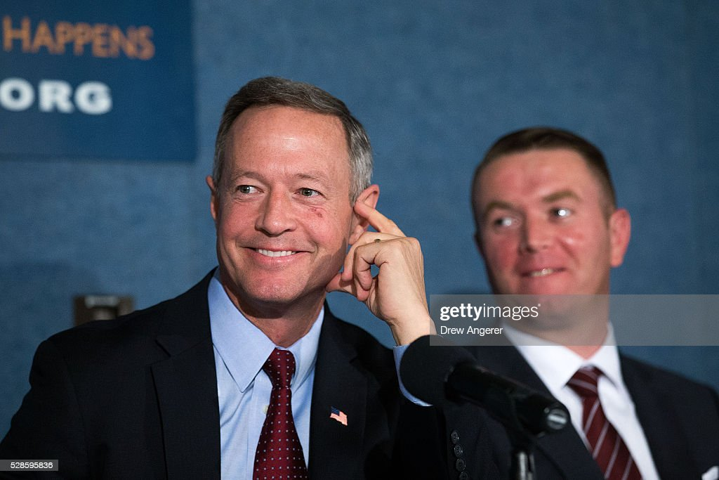 At L, <a gi-track='captionPersonalityLinkClicked' href=/galleries/search?phrase=Martin+O%27Malley&family=editorial&specificpeople=653318 ng-click='$event.stopPropagation()'>Martin O'Malley</a> (D-MD), former Maryland governor and former 2016 presidential hopeful, listens during panel discussion at the National Press Club, May 6, 2016, in Washington, DC. The panel, titled 'Words Matter: the U.S. Debate over Immigration, the Media, and the 2016 Election,' was organized by the American Bar Association.