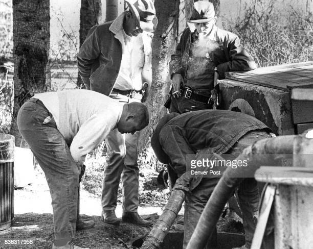 At left is Bill Watts deputy district attorney standing background are Dennis Potter and William W Goff of the LaPlata County Sheriff's Patrol and...