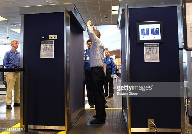 At Logan Airport new full body scanner were demonstrated for the media before they are put into use starting on Monday TSA staffer John Carter...