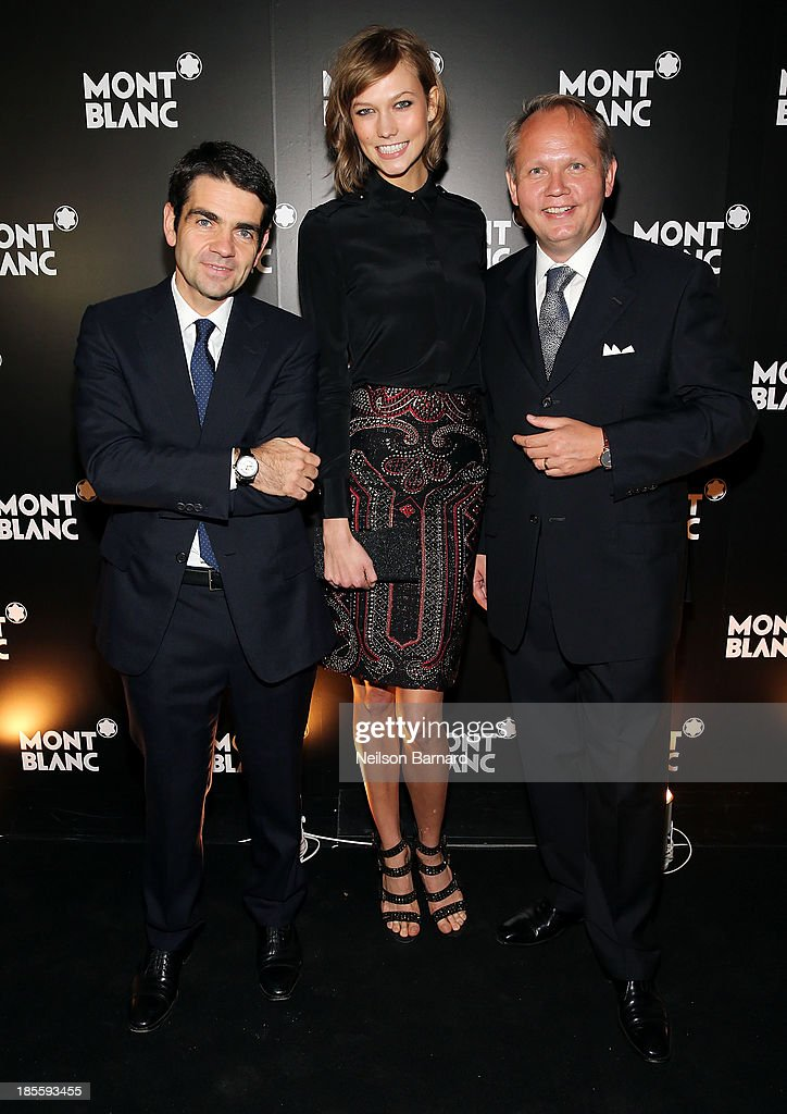 CEO at Montblanc <a gi-track='captionPersonalityLinkClicked' href=/galleries/search?phrase=Jerome+Lambert&family=editorial&specificpeople=4001752 ng-click='$event.stopPropagation()'>Jerome Lambert</a>, model <a gi-track='captionPersonalityLinkClicked' href=/galleries/search?phrase=Karlie+Kloss&family=editorial&specificpeople=5555876 ng-click='$event.stopPropagation()'>Karlie Kloss</a> and President & CEO at Montblanc North America <a gi-track='captionPersonalityLinkClicked' href=/galleries/search?phrase=Jan-Patrick+Schmitz&family=editorial&specificpeople=2160858 ng-click='$event.stopPropagation()'>Jan-Patrick Schmitz</a> attend Montblanc celebrates Madison Avenue Boutique Opening at Montblanc Boutique on Madison Avenue on October 22, 2013 in New York City.