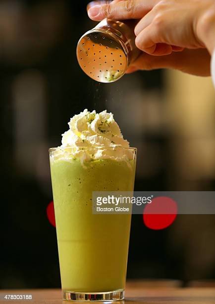 At Ogawa Coffee a matcha smoothie is made by barista Haruna Murayama Matcha is sprinkled on top of the whipped cream