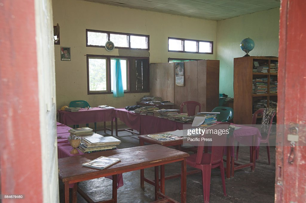 At one of Indonesia's oldest catholic schools a teacher and staff classroom Each year the student numbers are reduce because of insufficient funds...