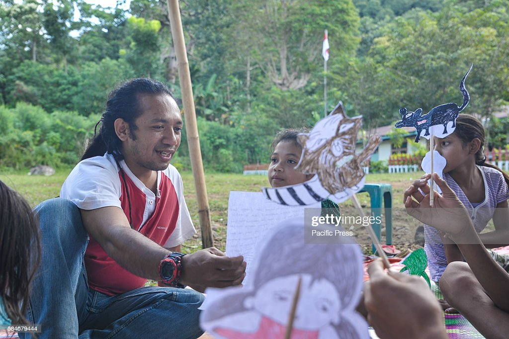 At one of Indonesia's oldest catholic schools a Voluntary worker from World Vision Indonesia Ignasius teaches the student a puppet show Each year the...