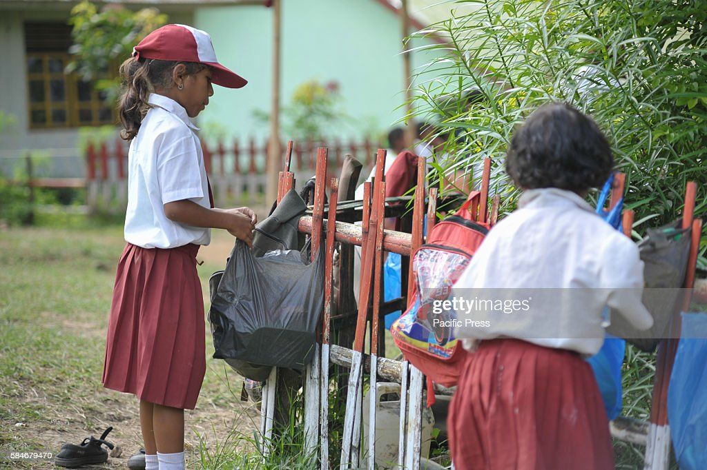 At one of Indonesia's oldest catholic schools students hang their bags on the fence Each year the student numbers are reduce because of insufficient...