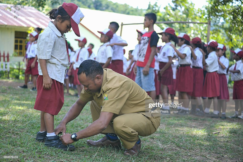 At one of Indonesia's oldest catholic schools the school head Marcell tightens a student's shoestring Each year the student numbers are reduce...
