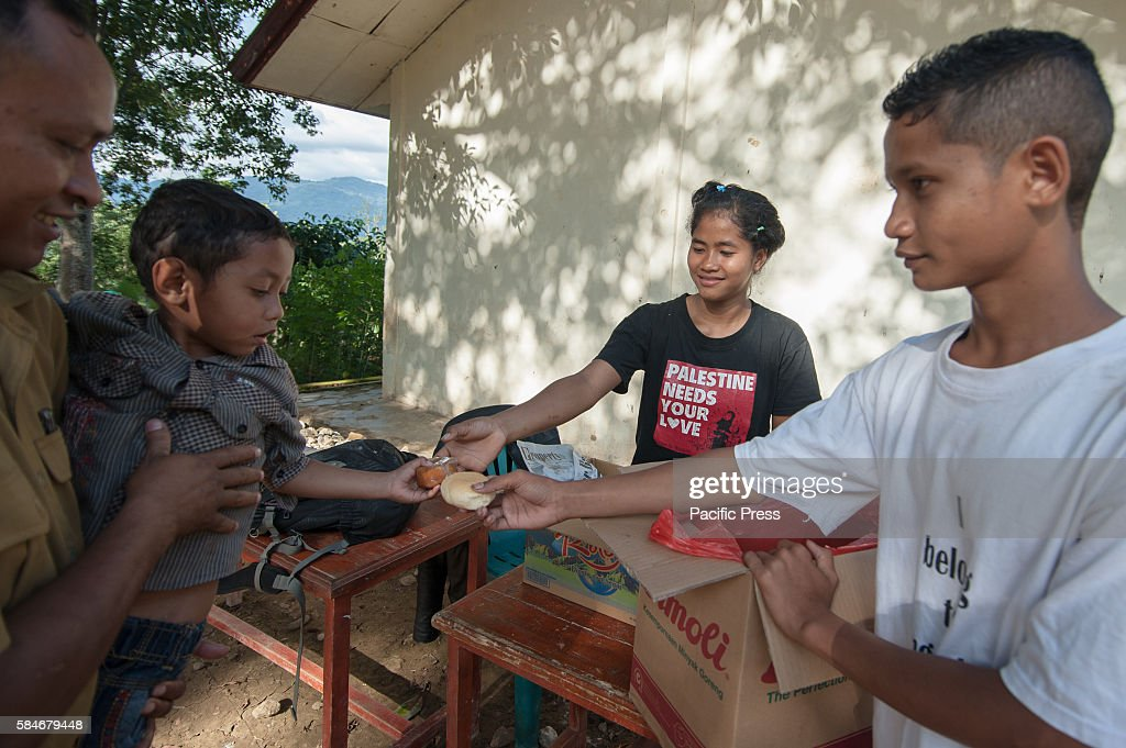 At one of Indonesia's oldest catholic schools the school head with his son get a snack Each year the student numbers are reduce because of...