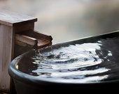 Water flows at an outdoor bath at an onsen somewhere in Japan.