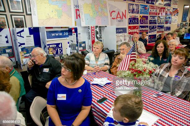 At Pat Roberts' campaign headquarters supporters listen to the senator Overland Park Kansas October 12 2014 At the time Roberts was campaigning for...