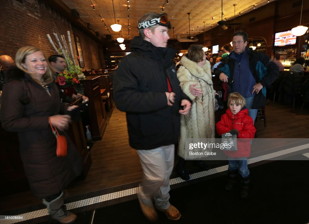 At right Kristin Atherton, in white fur coat, her brother Ray Mitkus, and her son Ricky, 5, all of South Boston, wait for a table at the Lincoln Tavern and Restaurant. Lincoln Tavern and Restaurant in Southie was thriving with business as locals crowded the establishment despite today's blizzard.