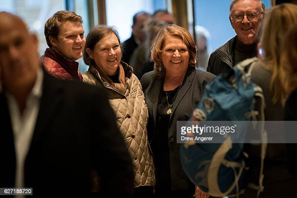At right Sen Heidi Heitkamp poses for photos with visitors at Trump Tower December 2 2016 in New York City Presidentelect Donald Trump and his...