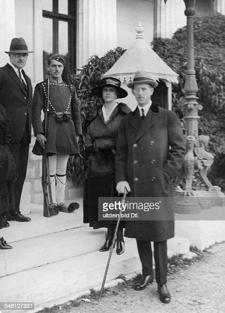 At right the parents of the Prince Prince Philip Duke of Edinburgh Prince Andrew of Greece and Denmark and Princess Alice of Battenberg at left...