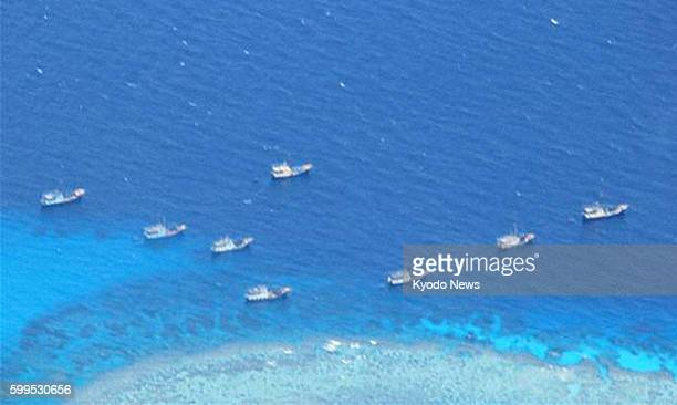 At Sea Photo taken by the Philippine Navy shows a fleet of fishing boats at Fiery Cross Reef in the South China Sea on July 17 2012 The Philippine...