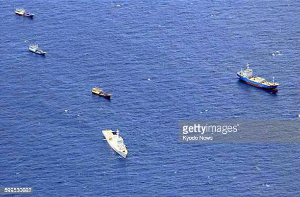 At Sea Photo taken by the Philippine Navy shows a fleet of fishing boats at Fiery Cross Reef in the South China Sea on July 17 2012 The vessel at...