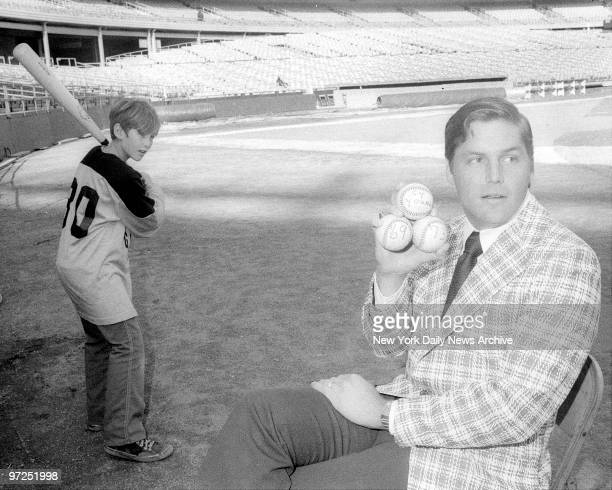 At Shea Stadium a smiling Tom Seaver flashes 1969 and 1973 baseballs indicating the two times the Met righthander has won the coveted Cy Young Award...