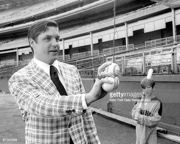 At Shea Stadium a smiling Tom Seaver flashes 1969 and 1973 baseballs indicating the two times the Met right hander has won the coveted Cy Young Award...