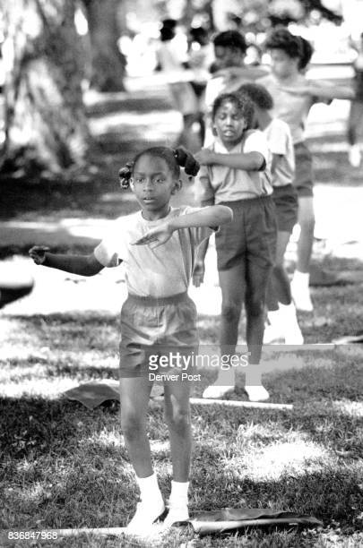 JUN 18 1989 *****at Start of Parade Manual High School Rohette Stewart age 8 of Denver Drum and Bugle Drill Team starts marching in Parade Credit The...