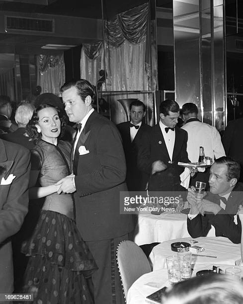 At Stork Club all the wagging tongues of Hollywood have wagged that Orson Welles and Dolores Del Rio film beauty are going to wed as soon as her...