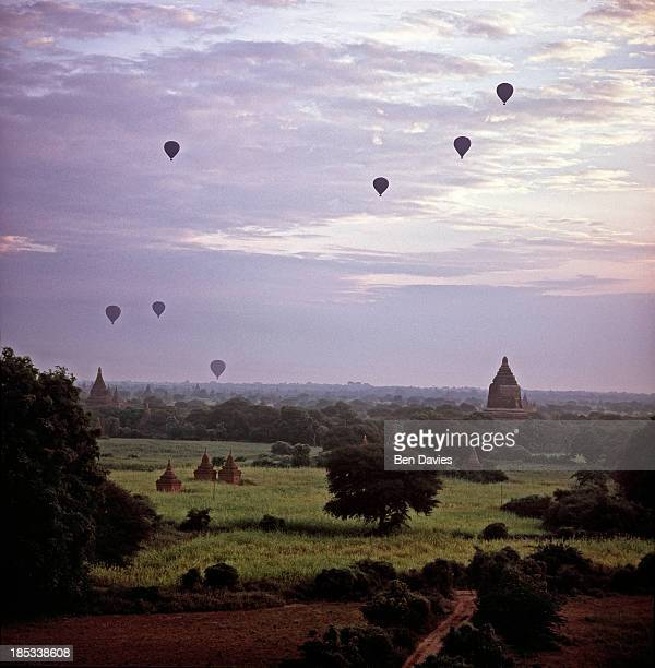 At sunrise hot air balloons fly over the great ancient temples of Bagan one of the major tourist attractions in Myanmar In all there are more than...