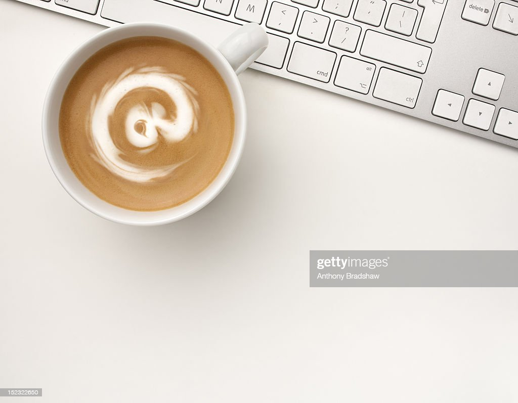 At symbol drawn in the foam of a coffee : Stock Photo