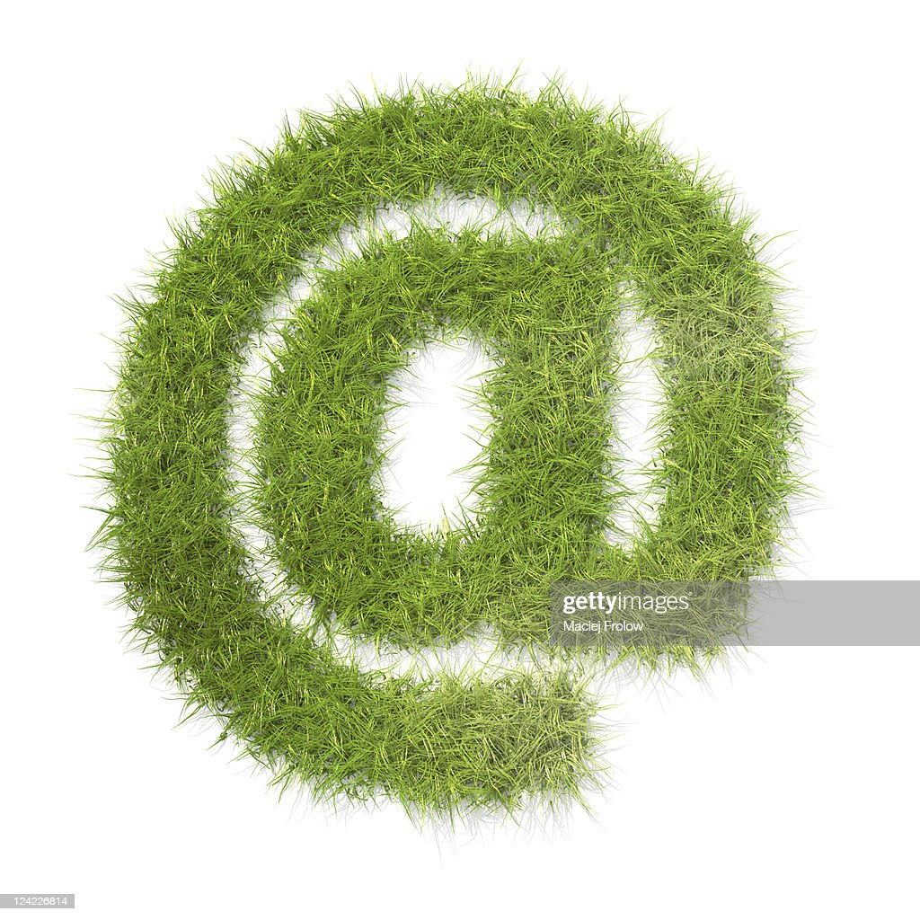 At symbol made of grass