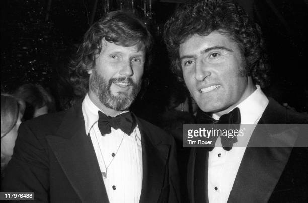 At Tavern on the Green American actor and singer Kris Kristofferson poses with a man as they attend a release party for his film 'A Star Is Born' New...