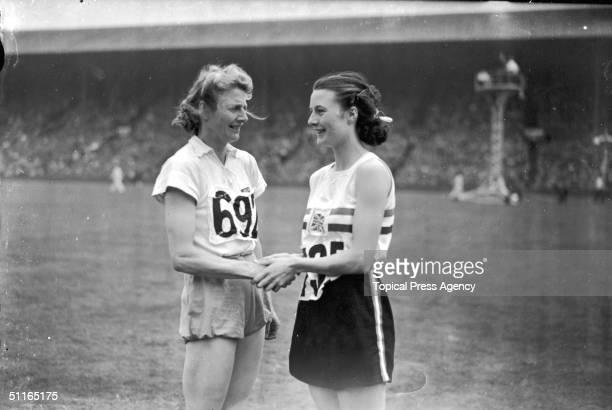 At the 1948 London Olympics women's 80 metres hurdles silver medallist Maureen Gardner congratulates the winner of the event Fanny BlankersKoen of...